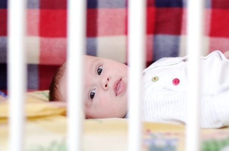 The baby lies in a white bed (4 months) Stock Photo - 17452048