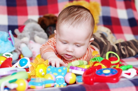 The four-months baby lies among toys  photo
