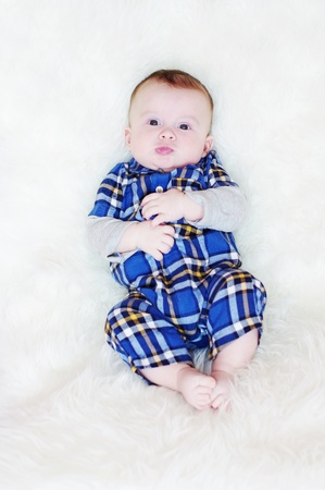 The five-months baby lies on a fur plaid Stock Photo - 17899941
