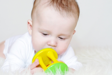 The baby with a rattle Stock Photo - 17927570