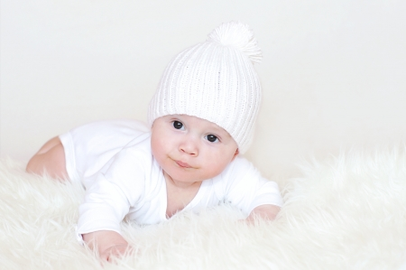 The baby in a white knitted hat  Stock Photo - 18000288