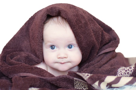 The baby covered by brown blanket on white background Stock Photo