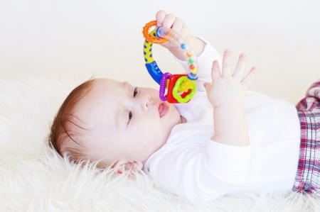 The baby with a rattle photo