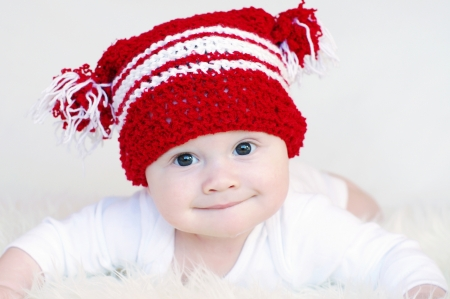 Portrait of the baby in red knitted hat photo