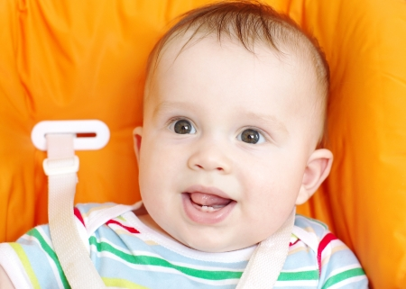 The first teeth at the six-months baby