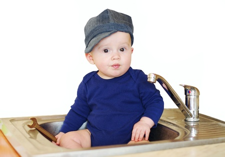 remount: The baby plumber repairs water tap  Stock Photo