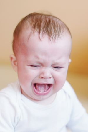 crying baby age of 7 months Stock Photo
