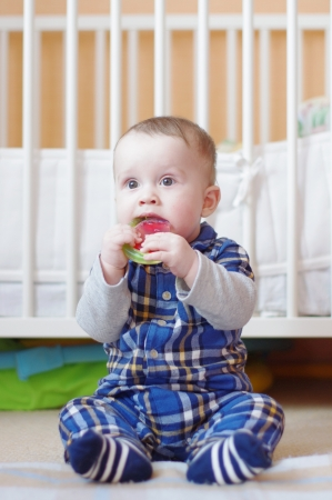 teething: baby with teething toy