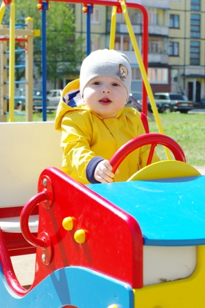 baby boy age of 8 months on playground photo