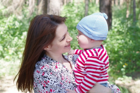 portrait of mother and son outdoors photo