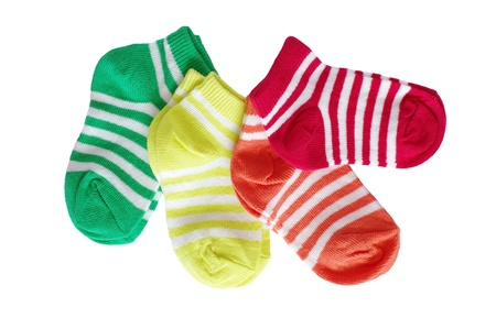four pairs of striped baby socks on white background Stock Photo