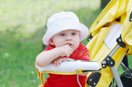 thoughtful baby boy on baby carriage