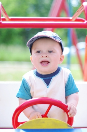 baby age of 9 months plays on playground outdoors