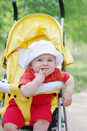 thoughtful baby on baby carriage