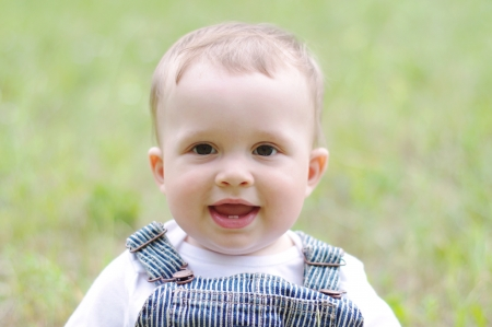 portrait of lovely baby boy outdoors Stock Photo