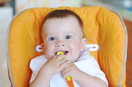 happy baby age of 9 months with spoon Stock Photo - 20686146