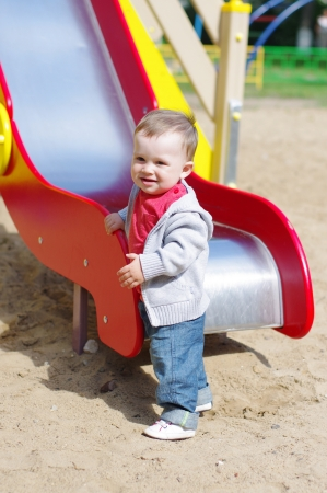nice baby boy age of 11 months on playground in summer Stock Photo
