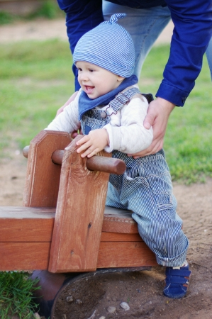 totter: baby age of 11 months on teeter totter