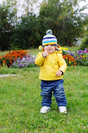 lovely baby age of 1 year walking in park
