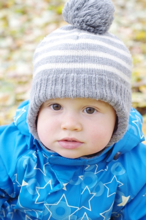portrait of lovely baby age of 1 year outdoors in autumn photo