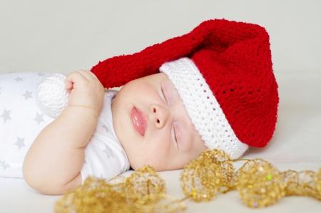 lovely sleeping baby age of 2 months in a New Years hat photo
