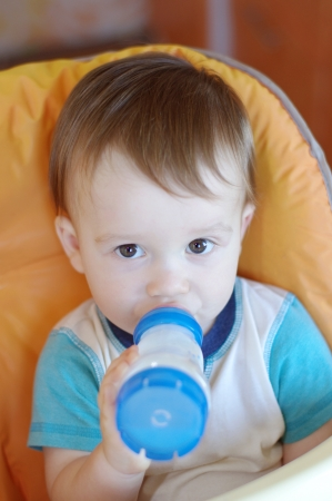 lovely baby boy age of 1 year with a small bottle photo