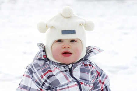 portrait of lovely baby age of 1 year in winter outdoors Stock Photo