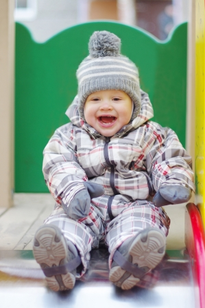 happy baby age of 1 year chuting outdoors photo