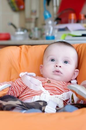 highchair: baby sitting on highchair
