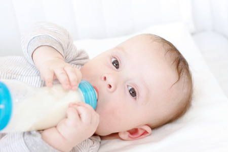 baby age of 5 months with small bottle