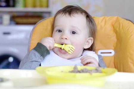 baby age of 15 months eats buckwheat groats photo