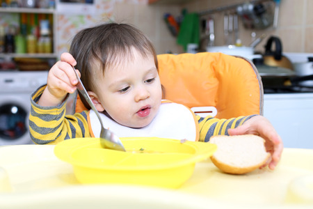 16 months baby eating soup and bread