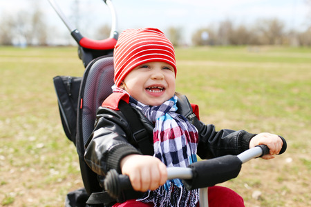 happy baby boy on tricycle  photo