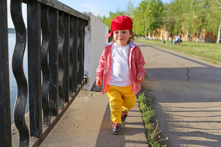 fashionably: fashionably dressed baby boy walking outdoors in summer