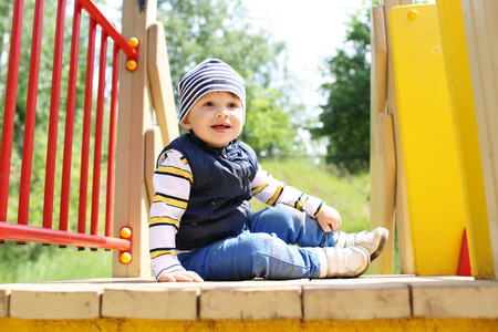lovely baby on playground in summer