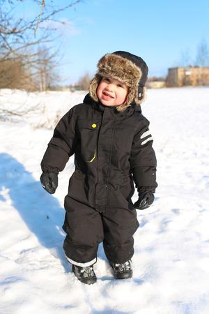 toddler walking: smiling 2 years toddler walking in winter
