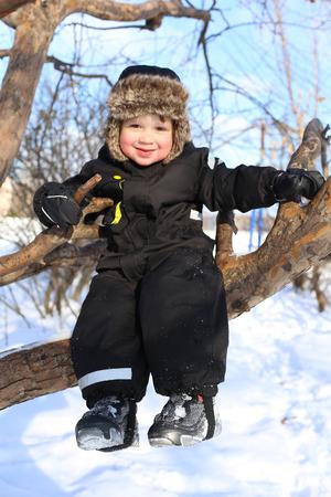 toddler walking: happy 2 year toddler walking in winter Stock Photo