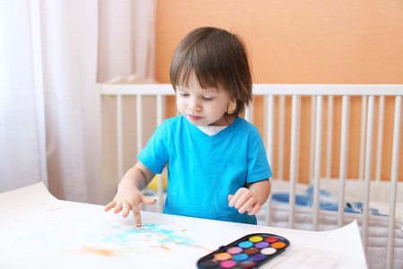 lovely little boy age of 2 years painting at home