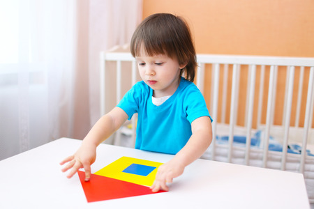 2 years little boy constructing house of paper details at home