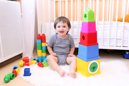 lovely baby age of 22 months playing toys Stock Photo