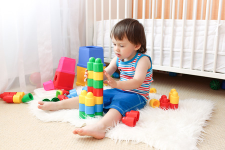 lovely baby (22 months) playing toys Stock Photo
