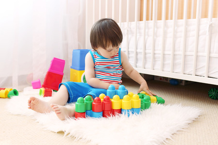 lovely baby boy with toys at home Stock Photo