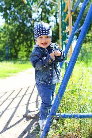 little boy walking in park