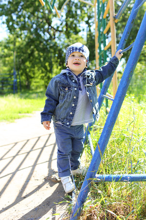 baby (22 months) on playground in summer Stock Photo
