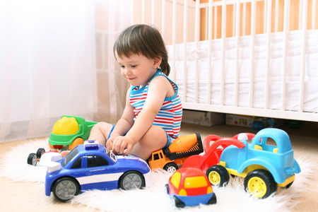 baby boy playing cars at home
