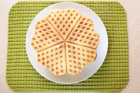 Stack of homemade waffles on a plate