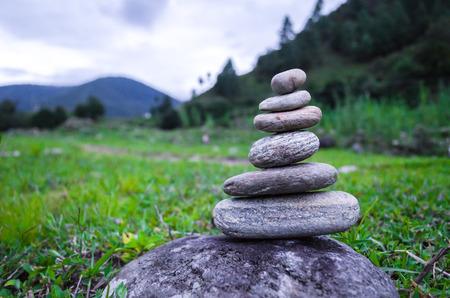 nature symbols metaphors: Stack of seven pebbles