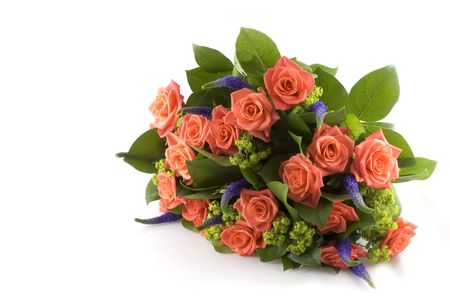 A bunch with orange roses and purple flowers Stock Photo