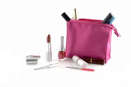 Pink make-up case filled with several make-up products photo