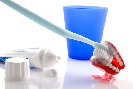 Brush your teeth with toothpaste and toothbrush